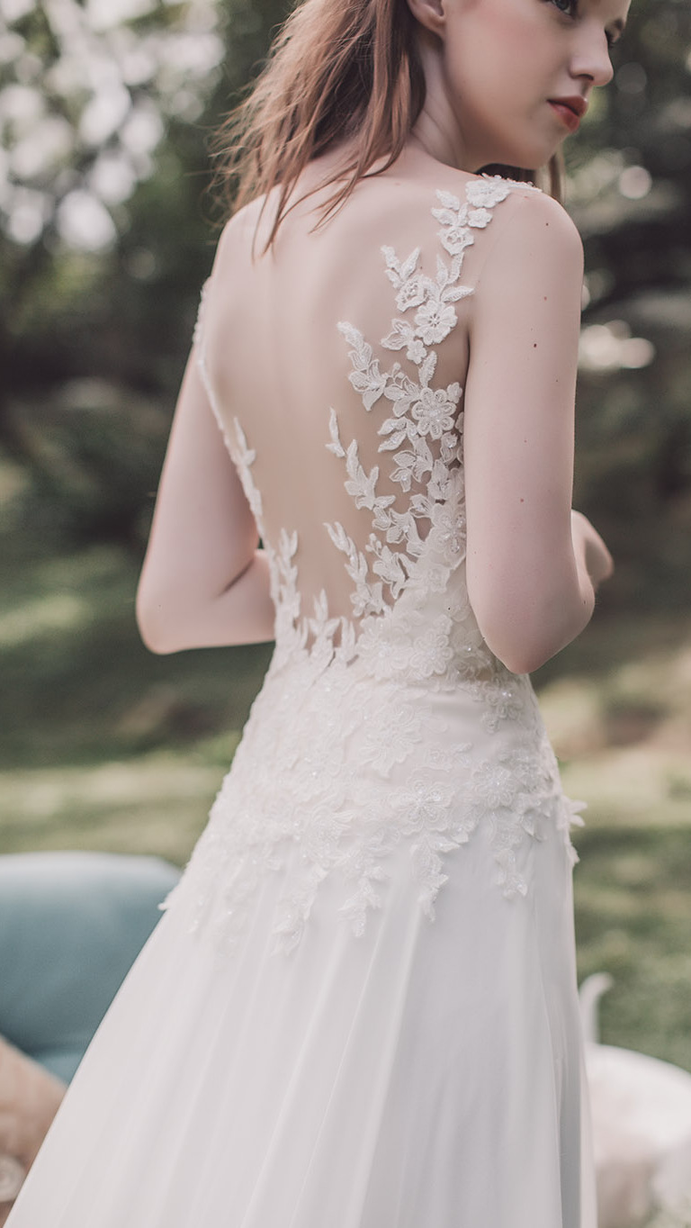 wedding dress featuring an illusion back