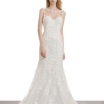 Mermaid wedding dress in lace and tulle. Bodice with bateau neckline and sheer overlay with lace appliqués. Plunging back with covered buttons.